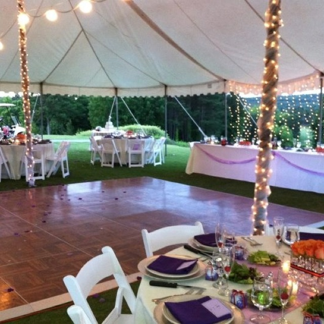 Tent wedding reception- love the lights on the poles, the white table clothes, and the wood dace floor!!