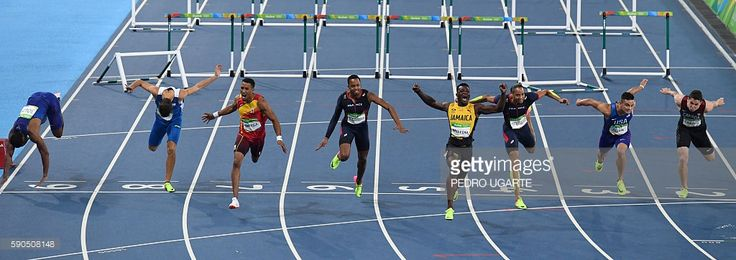 Jamaica's Omar McLeod (4thR) reacts as he crosses the finish line to win the Men's 110m Hurdles Final during the athletics event at the Rio 2016 Olympic Games at the Olympic Stadium in Rio de Janeiro on August 16, 2016. / AFP / PEDRO UGARTE (Photo credit should read PEDRO UGARTE/AFP/Getty Images)