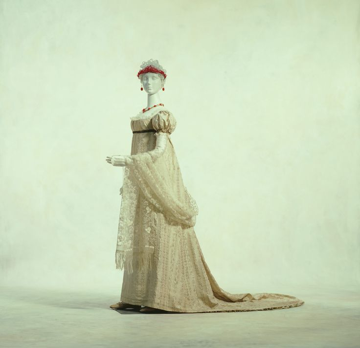 Gala Dress c. 1805- unknown (Country). This high-quality silk dress, with its magnificent elegance, was used by the royal court. At this point in time, thin, cotton dresses were wildly popular and the Lyons silk industry, important for the French economy, suffered a severe blow. In order to revive it, Napoleon Bonaparte encouraged the wearing of silk garments in the royal court. In 1811, he issued an Imperial decree that men and women must wear silk clothes at public ceremonies.