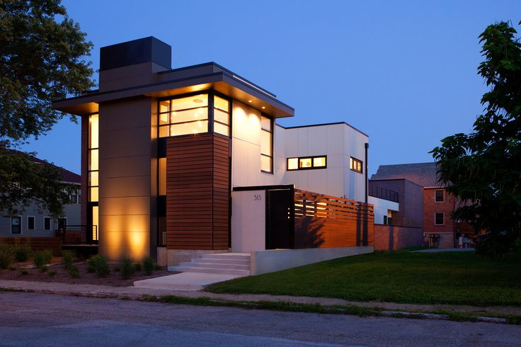 components are comprised of natural brick masonry veneer, monolithic cement panels and commercial glazing systems