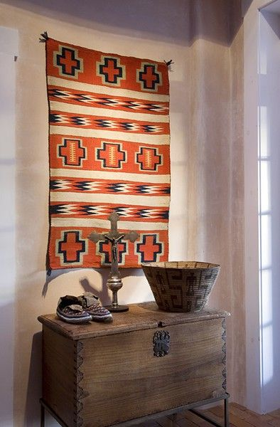 Navajo rug as a wall hanging creates a lot of visual interest in this small space. Great entryway idea.