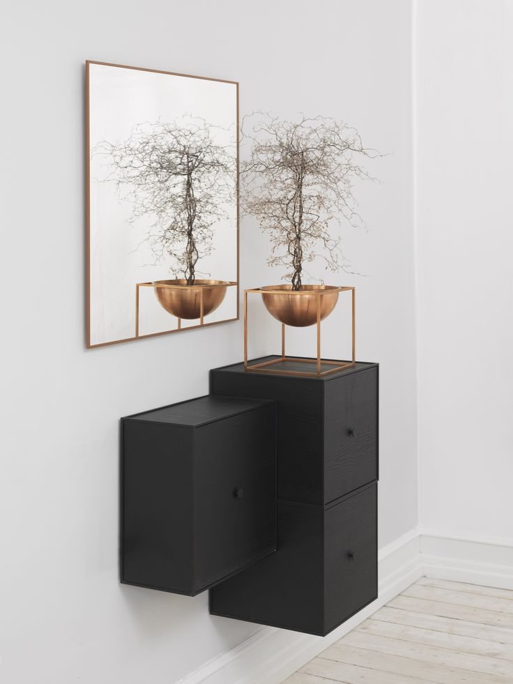 Frame can be combined in different sizes of blackstained ash with the View mirror and Kubus Bowl in copper to create a stylish entrance.