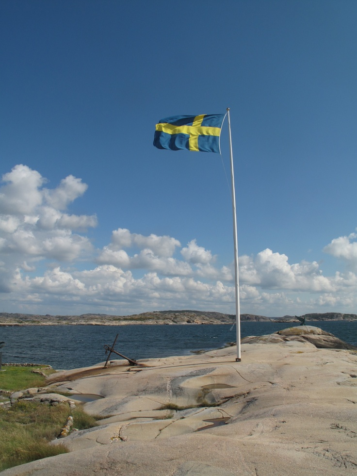 Beach in #Sweden with the Swedish flag.