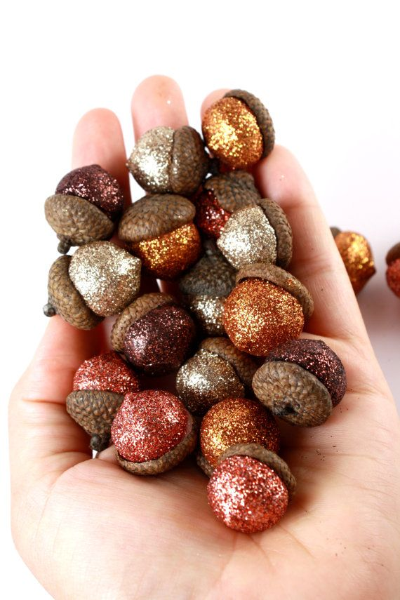 Apply glitter to the acorns then put them in a jar to display during fall.: