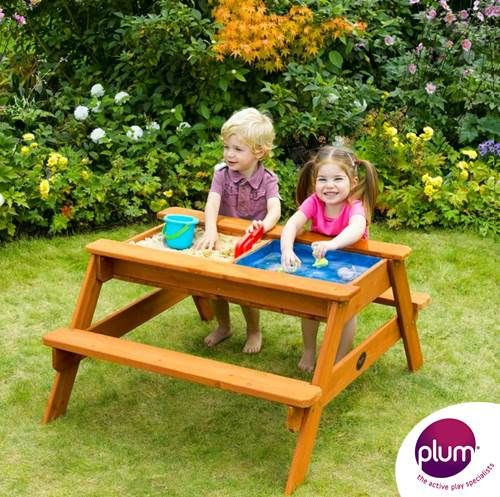 Picnic bench with two individual play pits hidden inside