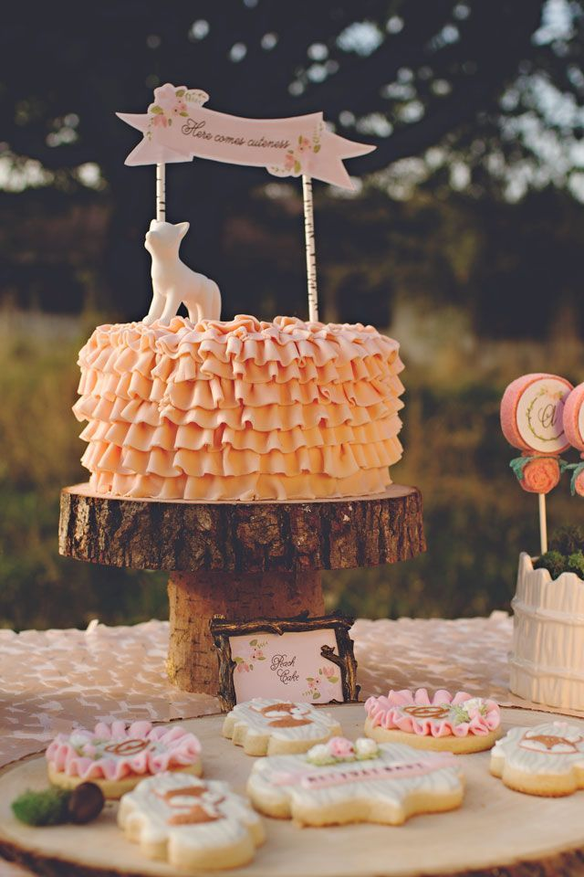 Love this woodland themed baby girl shower.  This peach ruffle buttercream cake is simply precious.