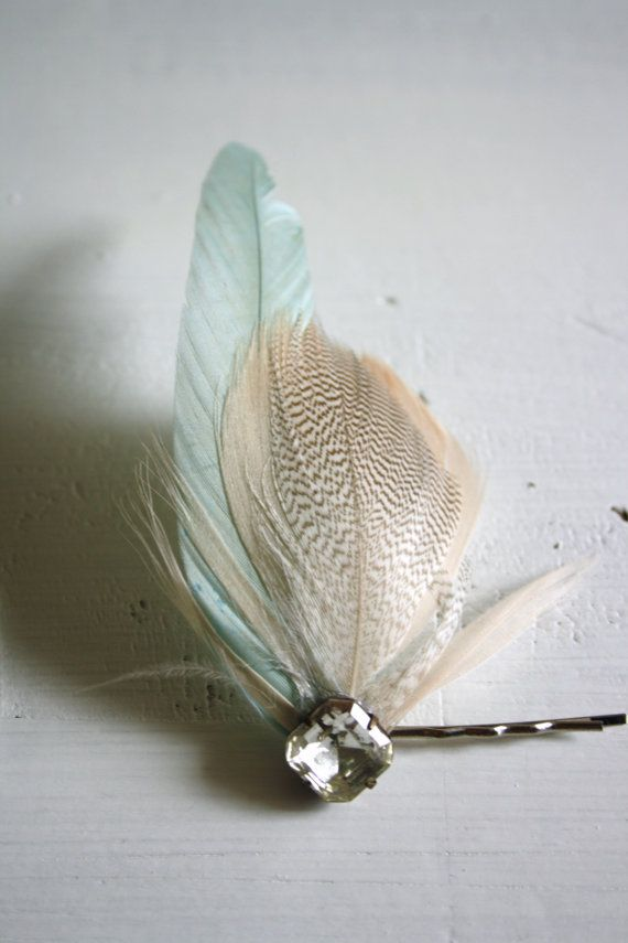 Feather Pins! I have a bunch and want to learn how to make more. They can dress you up in a split second.