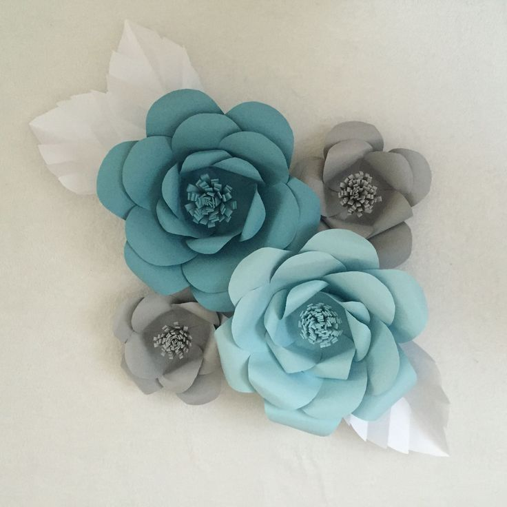 Learn how to create giant paper flowers for a paper flower backdrop. Great for events and weddings.