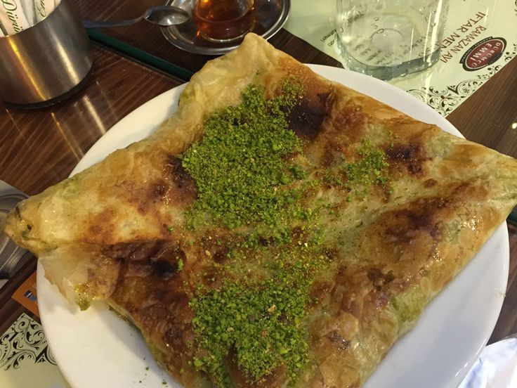Katmer is a Gaziantep specialty. A thin dough layered with syrup, cheese and pistachios.