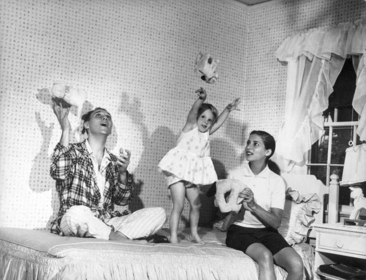 <b>Summer 1958</b> Ruth Bader Ginsburg and Martin Ginsburg play with their three-year old daughter, Jane, in her bedroom at Martin's parents' home in Rockville Centre, N.Y