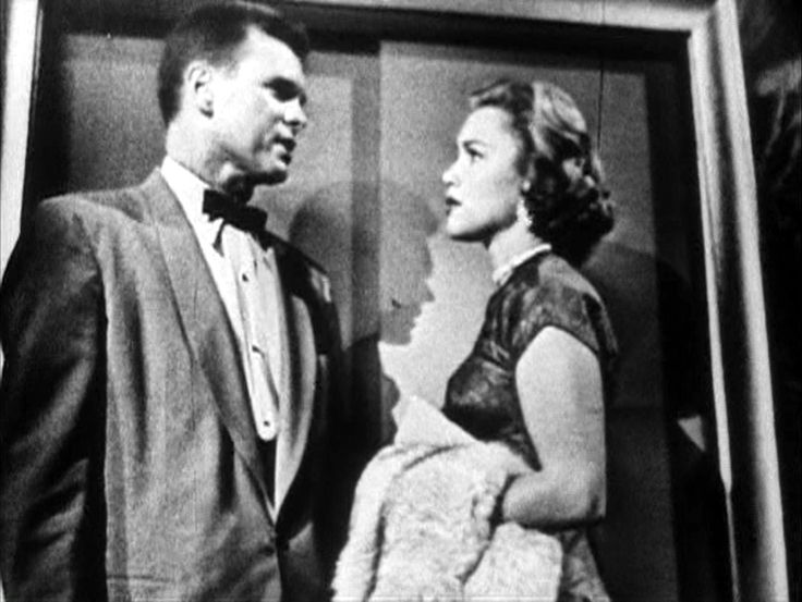 "Barry Nelson (as James Bond) and Linda Christian (as Valerie Mathis) in CBS' ""Casino Royale"" (1954)."