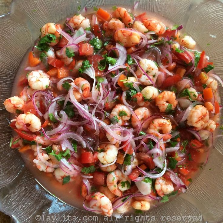 Classic Ecuadorian shrimp ceviche made with shrimp marinated in lime and orange juice with red onions, tomato and cilantro