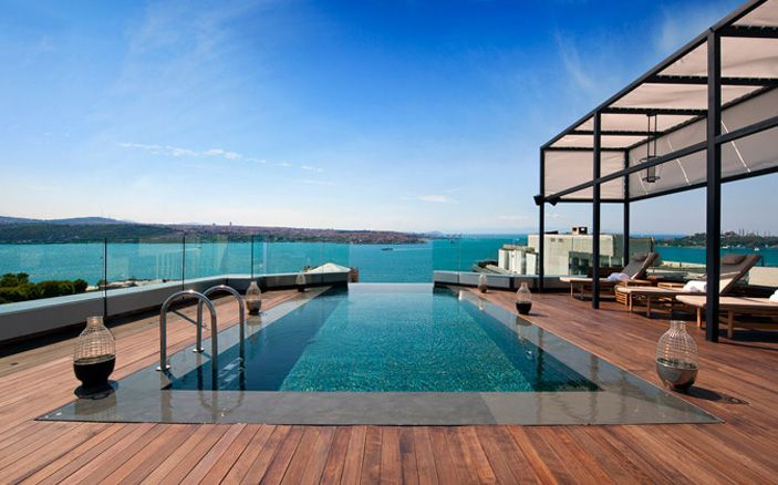 sleek pool with large wooden deck