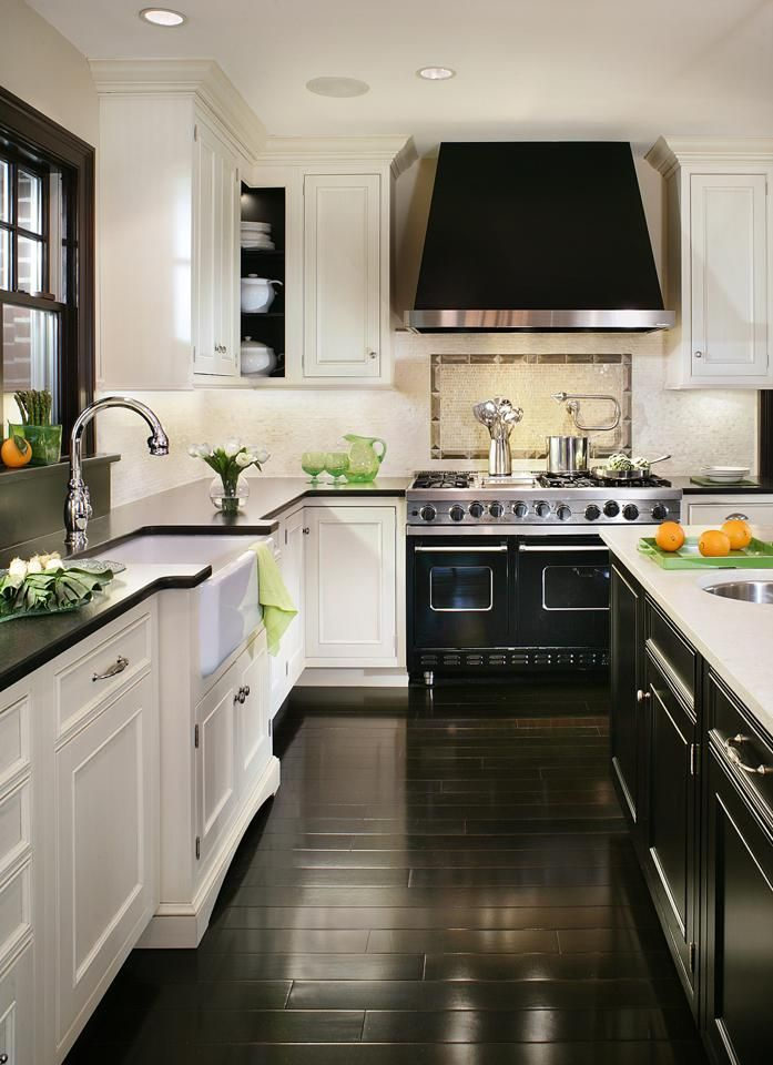 Love the black bench tops with the white cabinets .. oh that floor is just the best