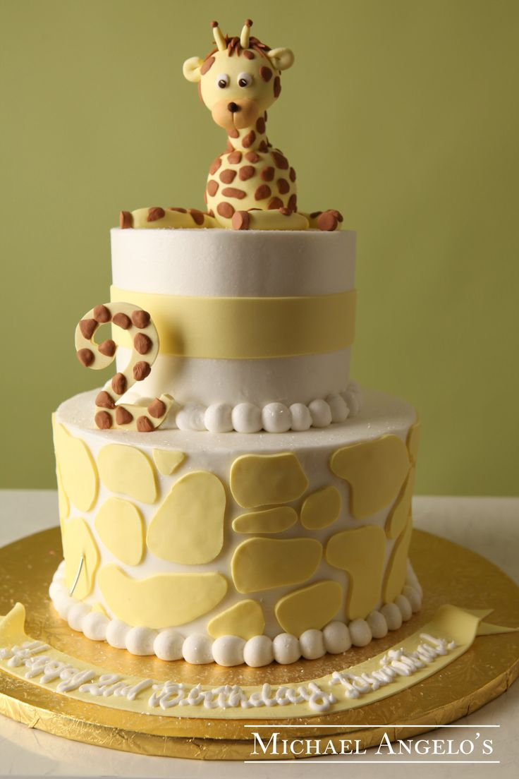Baby Giraffe #42Animals  This buttercream cake is made of two round tiers iced in buttercream. What makes this cake is the adorable topper that is handcrafted and painted to look so real.