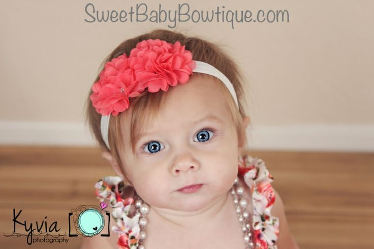Can she get any more ADORABLE?!? The MOST ADORABLE baby headbands and newborn headbands! www.sweetbabybowtique.com!   The Isabella Flower Coral Elastic Headband