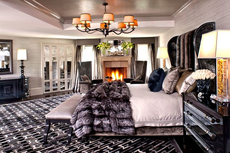"Focused on a reduced palette with black, white, gray and an infusion of neutrals and metallic, ""everything works together in harmony,"" says Andrews. With cashmere, fine wools, and silk, elegant glamour pours through the master bedroom. ""Kris likes luxurious and really good-to-touch, tactile things,"" he adds. ""Her personality is everywhere in her home."""
