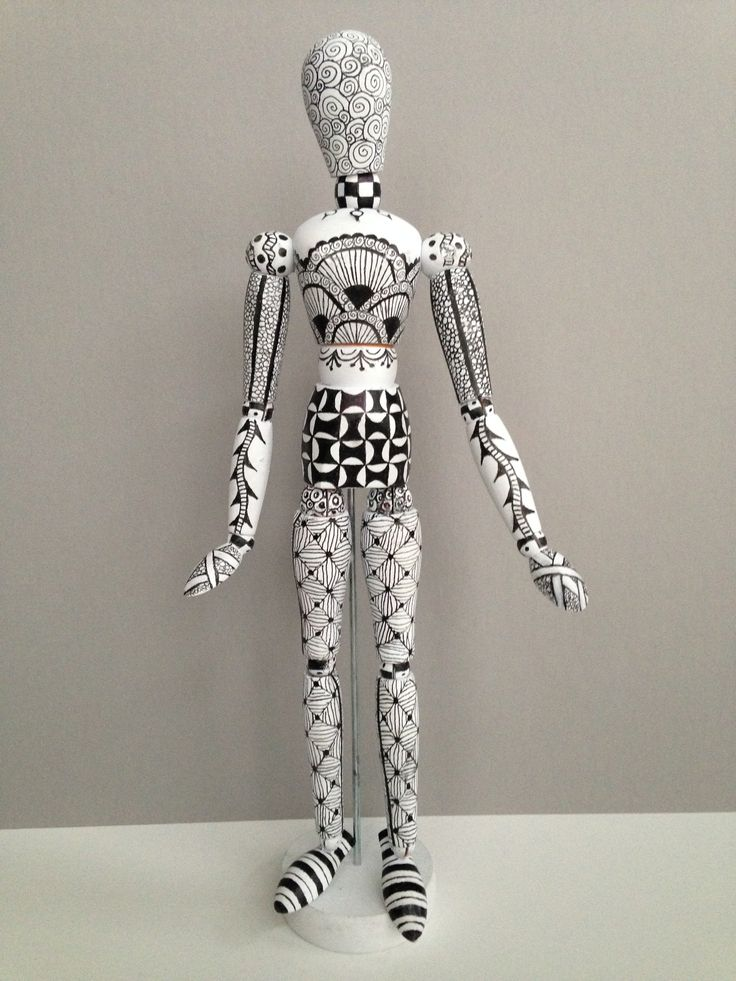 A tangled 30-year-old wood drawing mannequin, turned into a stylish addition to my studio! Black Micron pens over a flat white spray paint undercoat.