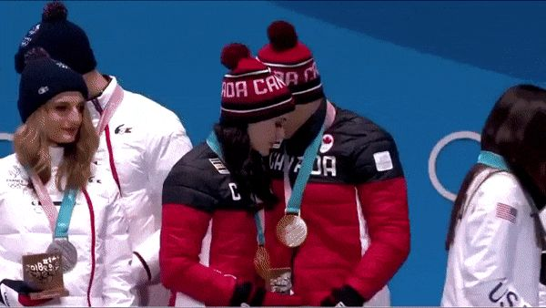 He lifts her off the podium even when she isn't wearing skates <3