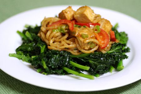 Spicy Peanut-Tofu Noodle Toss on a bed of Kale