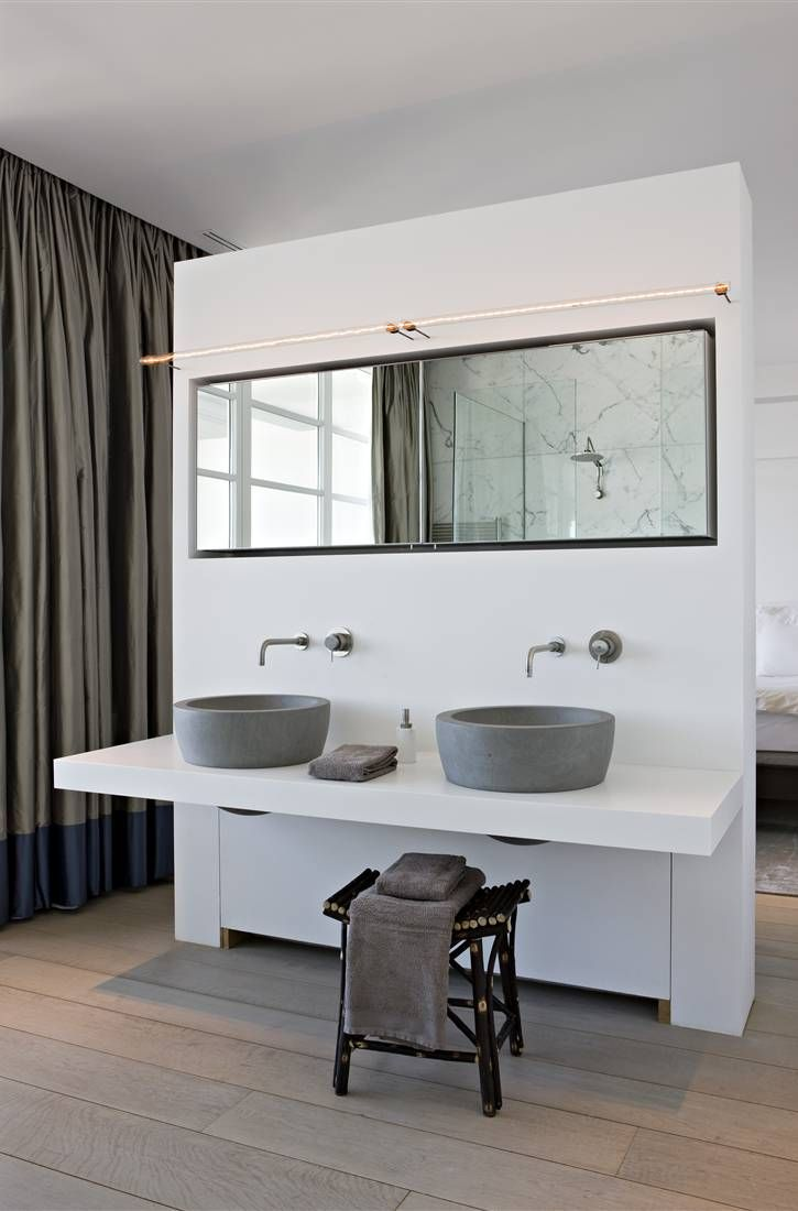"""Put the handles for the water towards the front and make the mirror bigger/ lower.. what a cool double sink that happens to be #accessible but clearly not designed with that first in mind.  Putting a stool under what could be a """"roll under"""" sink is a perfect way of preparing for whatever you may need in advance, but designing in the way that meets your style needs now. Comments by Gail Zahtz."""