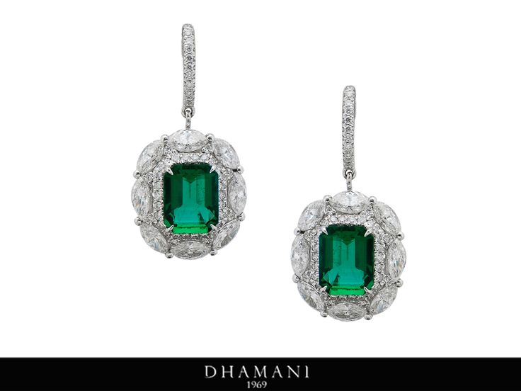 #Glamourous 18K White Gold #Emerald and #Diamond #Earring weighing 11.79 Grams studded with 4.23 Carats of #Natural Zambian Emeralds and 4.73 Carats of Natural Marquise & Round Shape Diamonds AT - Dhamani The Dubai Mall#Dhamani1969 #luxury
