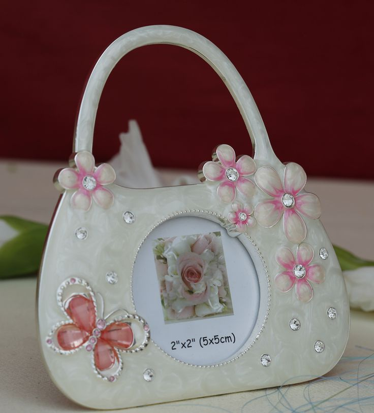 Photo Frame Small Hand Bag - Crafted on resin and accentuated with a silver due, embedded crystals with pink crystal shaded butterfly makes it a master piece for decorating your child's room and gifting purposes.