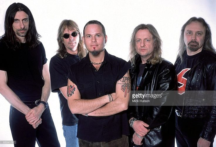 Photo of Ian HILL and JUDAS PRIEST and Scott TRAVIS and Glenn TIPTON and Tim Ripper OWENS and KK DOWNING; L-R: Scott Travis, Glenn Tipton, Tim 'Ripper' Owens, KK Downing, Ian Hill - posed, studio, group shot