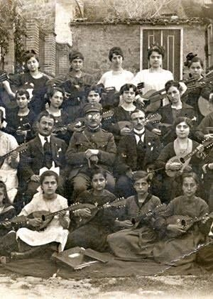 "General Alexander Mazarakis-Ainian amongst a mandolin players' group of the Girl's School ""The Theodorideia"", Rodosto, July 1920."