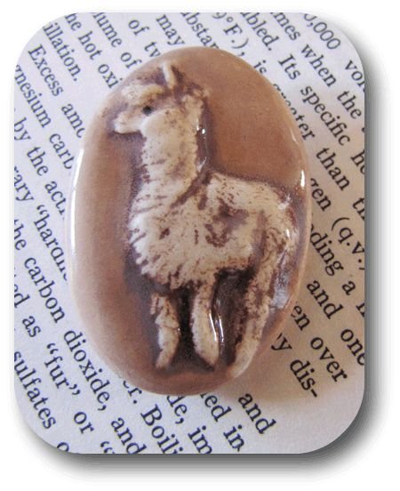 Alpaca buttons.  http://claybuttons.com/ButtonPages/Animal.html