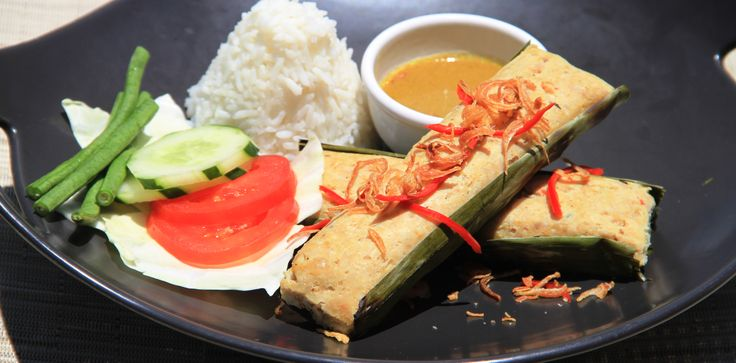 Otak-Otak Fish cakes with aromatic spices and wrapped in a banana leaf