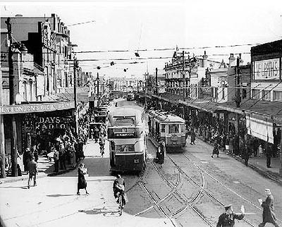 Old Bondi Junction before they took the trams away. We used to go shopping on Saturday mornings. The shops all closed at 12 noon.