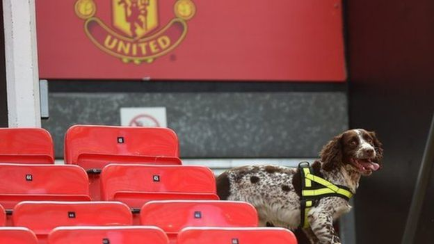 Police sniffer dogs were used at Old Trafford as part of the security check after a bomb alert resulted in the postponement of the Manchester United v. Bournemouth game