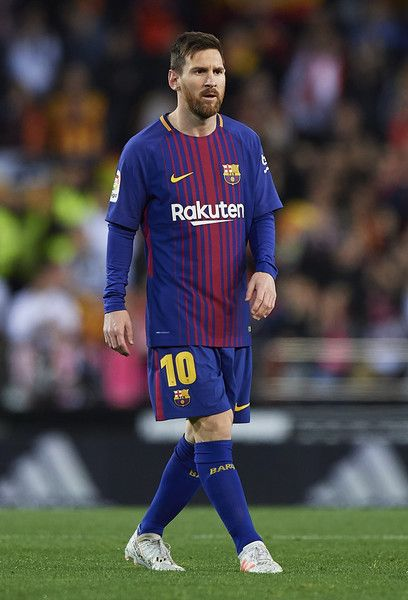 Lionel Messi of Barcelona looks on during the La Liga match between Valencia and Barcelona at Estadio Mestalla on November 26, 2017 in Valencia, Spain.