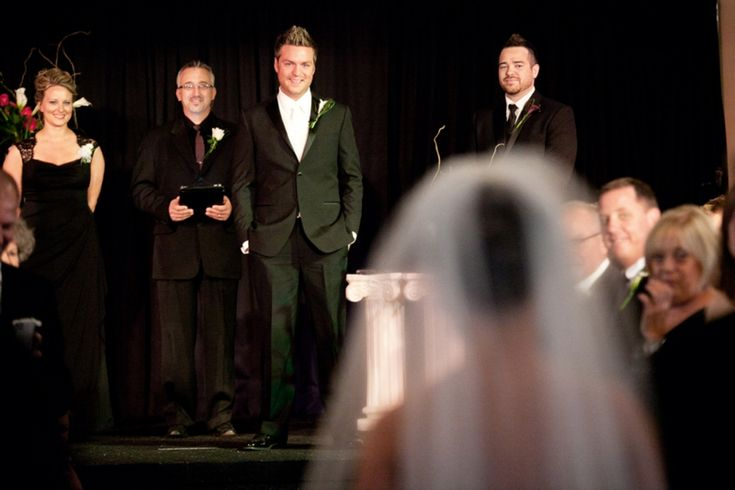 love this shot with grooms first reaction of seeing the bride!