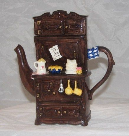 Novelty Brown Cupboard and Utensils Collectible Tea Pot Teapot, or something like, I collect different teapots.