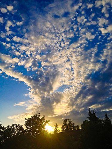 Setting sun and erupting clouds