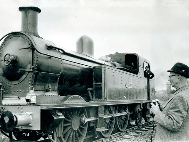 Railway Preservation Society Of Ireland. Mr Dave Gallagher who was an engine driver for 26 years on the Canadian Pacific Railway, takes a picture of the Lough Ern steam engine when he visited the Railway Preservation Society Of Ireland third annual Open Day at Whitehead. Mr Gallagher left Donegal in 1925 to go work in Canada. 3/7/1971
