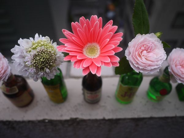 Reuse your favorite bottles (or find some interesting ones at a vintage shop) for single feature flower vases.