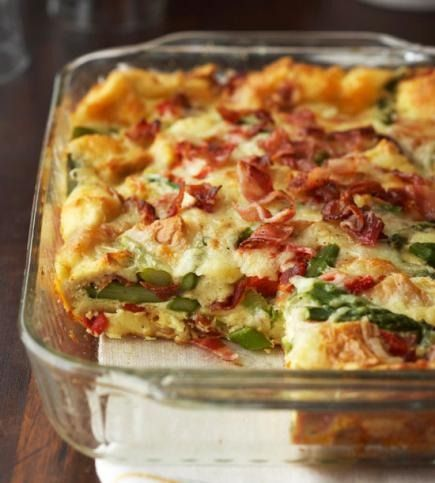 Asparagus, bacon and roasted red sweet peppers update a classic breakfast casserole mix of eggs, bread and cheese.