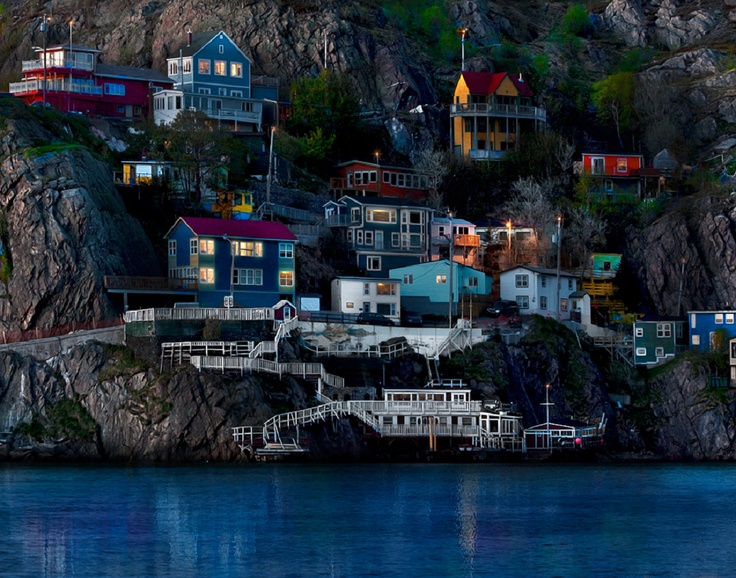 This is a neighbourhood in St. John's, Newfoundland called 'The Battery'. It's a community of solid, salt of the earth folk who've built their homes right into the cliff face. More than one window that I peered into had a boulder in the livingroom. No kidding! I felt this neighbourhood really represented the cheerful, obstinate, resourceful spirit of Newfoundland.    http://en.wikipedia.org/wiki/The_Battery,_St._John's