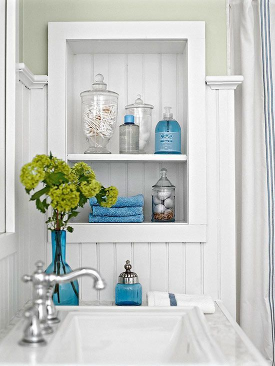 Clear Glass Cylinders Look Flawless And Provide Pretty Bathroom Storage.