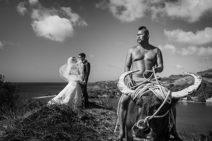 Yumee returned to her childhood home in Guam for her wedding to Chris, choosing the picturesque southern tip of the island to remember her childhood memories. The man on the buffalo, who appeared by chance, is the caretaker of the lands in the area. Image by Marcus Bell
