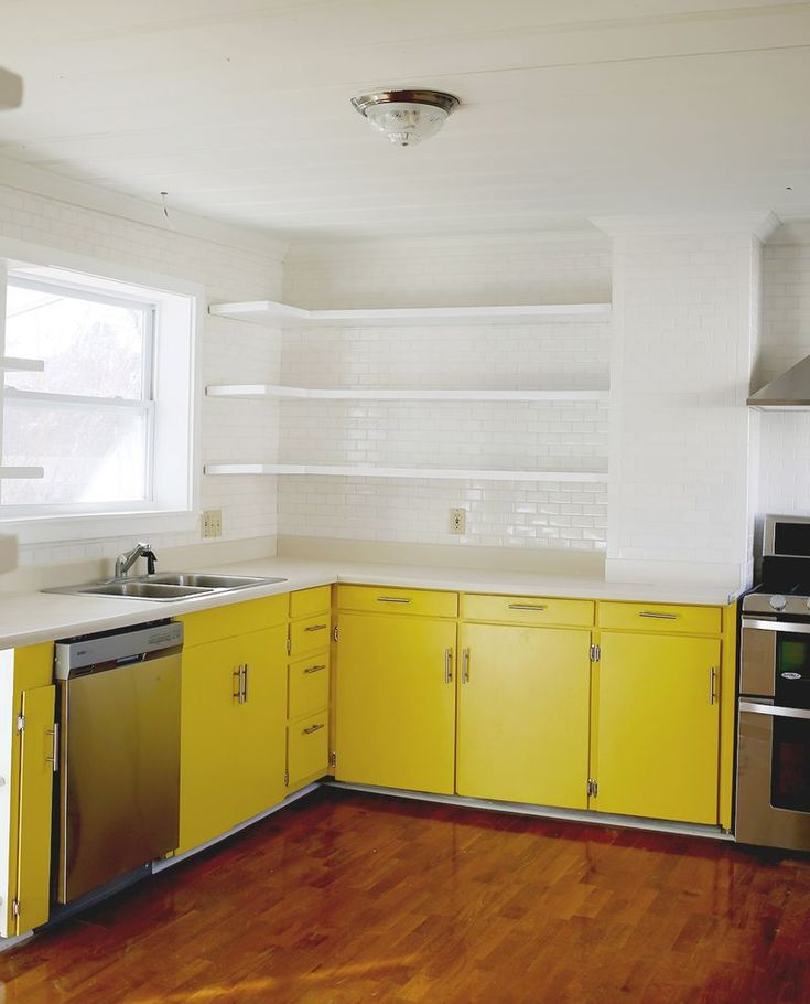 Like usual, not crazy about the yellow but I love the kitchen itself  A Beautiful Mess kitchen updates