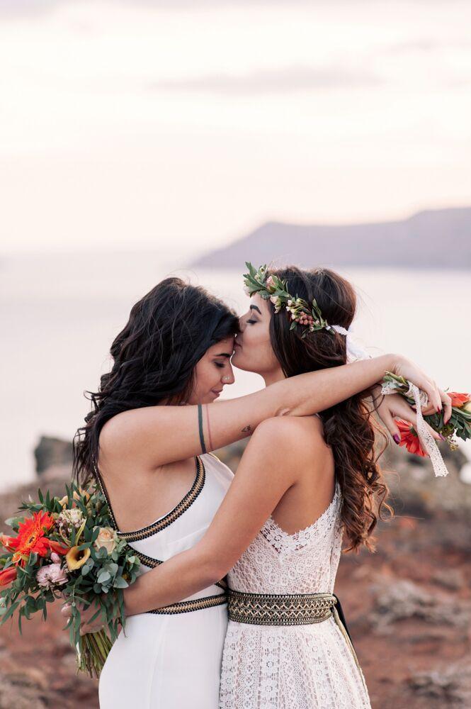 Colorful Bohemian Wedding Inspiration off the Coast of Santorini- flower crown- same sex couple shot