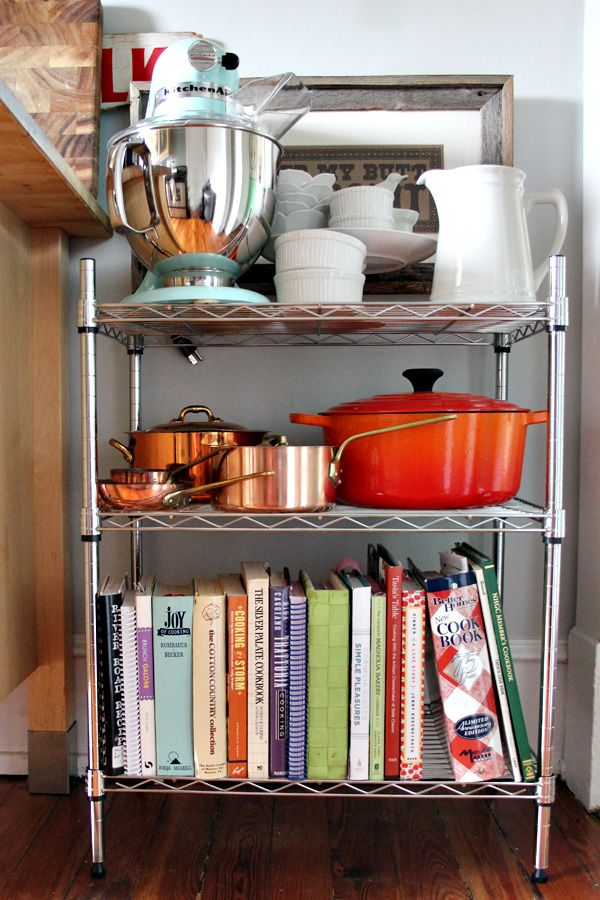 Add extra storage space to your kitchen with a wire shelving unit. Even a small 3-tier shelf can give you extra space for your cookbook collection, small appliances, and dishware! #storage #organization