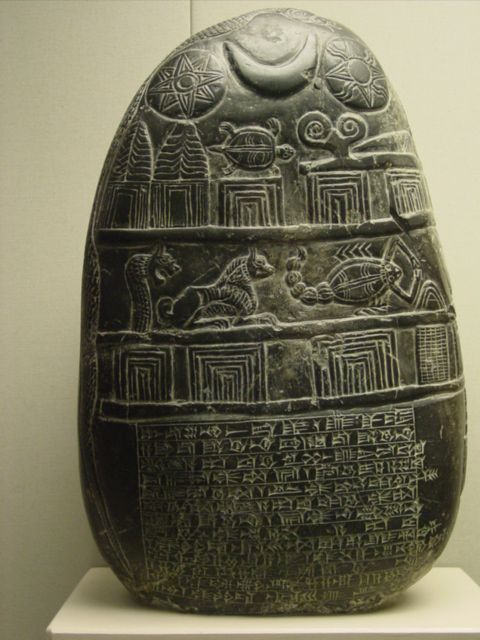 Sumerian Boundary stone  - kudurru (1125-1100 BC). The cuneiform inscription  records the granting by Eanna-shum-iddina, the governor of the Sealand, of five gur of corn land in the district of Edina in south Babylonia to a man called Gula-eresh.