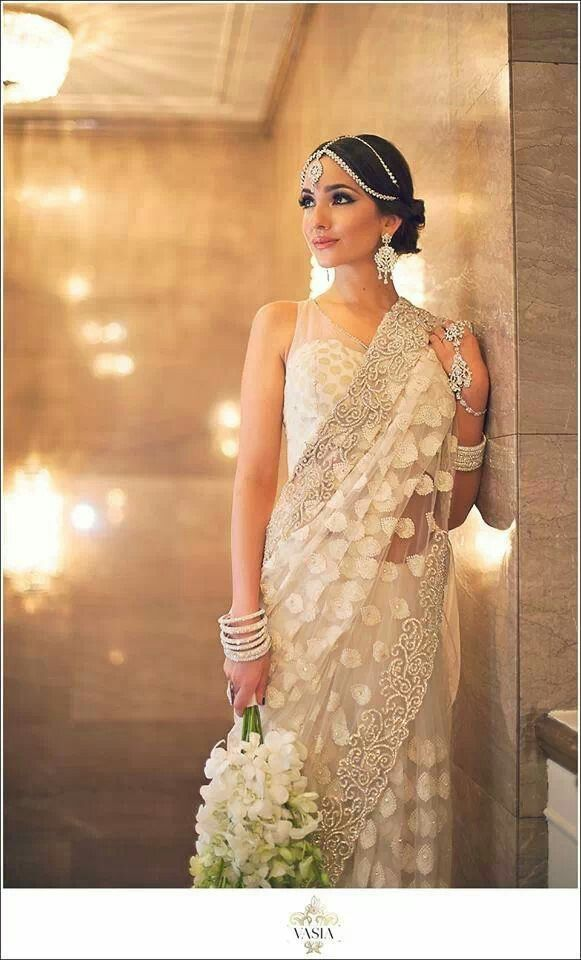A delicate sheer white saree, a lovely maang tika, and a lovely wedding bouquet make quite an elegant Indian Bride! A Chris Pine wedding goal.