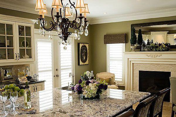 Kitchen space designed by Glen & Jamie from Peloso Alexander Interiors. #kitchen #dining #chair #table #fireplace #design #GlenandJamie