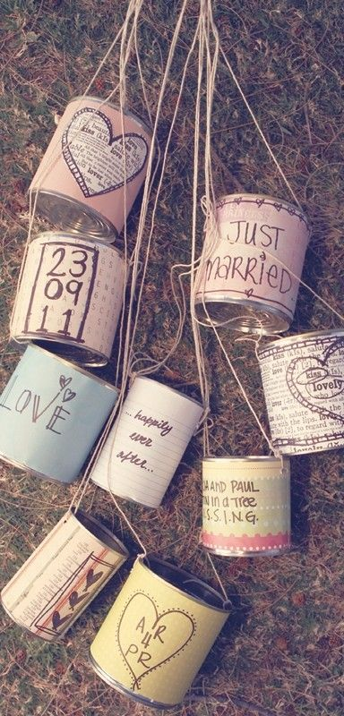 This is a must :) ♥ Create these DIY Wedding Tin Cans by attaching your doodle-work and happy sayings on empty tin cans and then using string or ribbon to tie it to your pick of transportation!